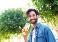 Handsome young  man smiling with a glass of beer outdoor Royalty Free Stock Photo