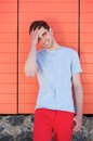 Handsome young man smiling with hand in hair outdoors portrait of a Royalty Free Stock Photography