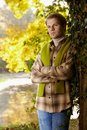 Handsome young man standing at tree outdoor Stock Photo