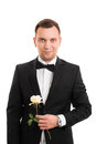 Handsome young man in a suit holding a flower Royalty Free Stock Photo