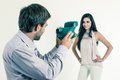 Handsome young man taking photos of beautiful girl men hispanic with instant camera isolated on white Stock Photography