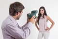 Handsome young man taking photos of beautiful girl men latin with instant camera isolated on white Stock Photography