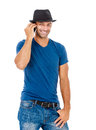 Handsome young man talking on the phone a against a white background Royalty Free Stock Photos