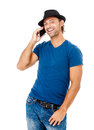 Handsome young man talking on the phone a against a white background Royalty Free Stock Photo