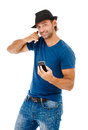 Handsome young man talking on the phone a against a white background Royalty Free Stock Images
