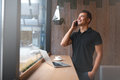 Handsome young man talking on phone and smiling Royalty Free Stock Photo
