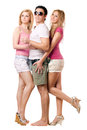 Handsome young man and two happy girls men isolated Royalty Free Stock Photos