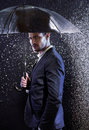 Handsome young man with an umbrella Royalty Free Stock Photo