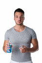 Handsome young man using mouthwash isolated on white to clean his teeth and mouth background Royalty Free Stock Images