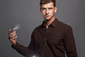Handsome young man using perfume.perfume bottle and spraying fragrance Royalty Free Stock Photo