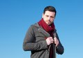 Handsome young man with winter jacket outdoors close up portrait of a Royalty Free Stock Image