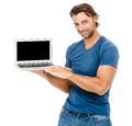 A handsome young man working on his laptop against while background Royalty Free Stock Photo
