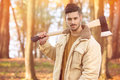 Handsome young men with axe Royalty Free Stock Photo