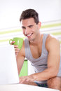 Handsome young men with laptop smiling man drinking coffee and using in morning Stock Image
