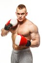 Handsome young muscular man wearing boxing gloves Stock Photo