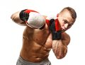 Handsome young muscular man wearing boxing gloves Stock Photography