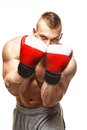 Handsome young muscular man wearing boxing gloves Stock Images