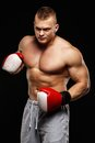 Handsome young muscular man wearing boxing gloves Stock Photos