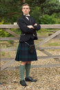 Handsome young scotsman in a kilt and full dress outfit Royalty Free Stock Image