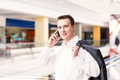 Handsome young and successful businessman talking on his mobile phone in a business center Royalty Free Stock Images
