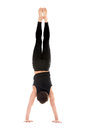 Handstand back view sporty young man working out yoga pilates fitness training doing adho mukha vrksasana downward facing tree Royalty Free Stock Photography