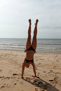 Handstand  on the beach Stock Photos