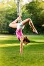 Handstand exercise cute young woman doing exercises in the park Stock Image