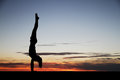 Handstand in sunset female gymnast doing Stock Image