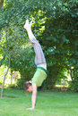 Handstand woman doing vertical in the garden Royalty Free Stock Photos