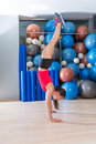 Handstand woman workout at gym and swiss balls with background Stock Photo