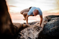 Handstand yoga pose by man on the beach near the ocean Royalty Free Stock Photo