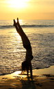 Handstands on the beach a teenage girl does a handstand at sunset manuel antonio costa rica Royalty Free Stock Photos