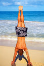 Handstands in the Sand Stock Photo