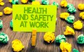 Handwriting text Health And Safety At Work. Concept meaning Secure procedures prevent accidents avoid danger Paperclip retain writ Royalty Free Stock Photo