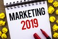 Handwriting text Marketing 2019. Concept meaning New Year Market Strategies Fresh start Advertising Ideas written on Notebook Book Royalty Free Stock Photo