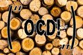Photo : Handwriting text Ocd. Concept meaning Obsessive Compulsive Disorder Psychological Illness Medical Condition Wooden background woman blackboard