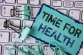 stock image of  Handwriting text Time For Health. Concept meaning Lifestyle change health awareness wellness nutrition care written on Sticky Not