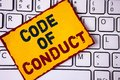 Handwriting text writing Code Of Conduct. Concept meaning Follow principles and standards for business integrity written on Sticky