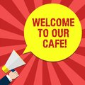 Handwriting text writing Welcome To Our Cafe. Concept meaning Greeting receiving showing in restaurant good attention Hu Royalty Free Stock Photo