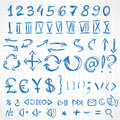 Handwritten icons and numerals from rough pencil strokes on of exercise book in cell Royalty Free Stock Images