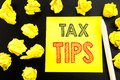 Handwritten text showing Tax Tips. Business concept writing for Taxpayer Assistance Refund Reimbursement written on sticky note pa Royalty Free Stock Photo