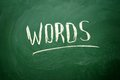 Handwritten words word with white chalk on a blackboard Stock Photos
