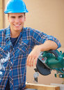 Handy man resting on a bench saw during work Royalty Free Stock Image