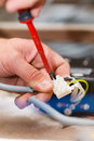 Handy man working with cables electrician assembling light Stock Photo