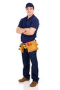 Handyman arms crossed smiling young with Stock Photography