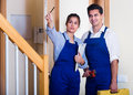 Handyman and  assistant in uniform Royalty Free Stock Photo
