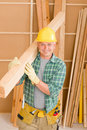 Handyman carpenter mature carry wooden beam Royalty Free Stock Photography