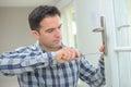 Handyman fitting new door