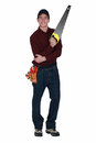 Handyman with a handsaw stood Stock Image