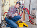 Handyman happy showing thumbs up Stock Photo